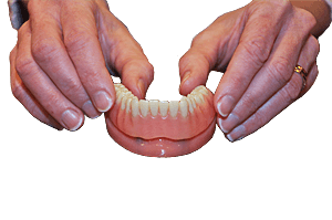 denture in place on dental implant